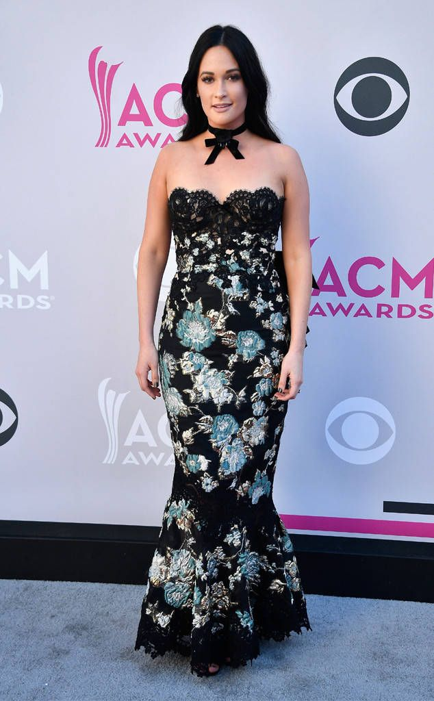 "Kacey Musgraves from ACM Awards 2017: Red Carpet Arrivals  Kacey is no ""Dime Store Cowgirl"" in this floral gown with lace detailing."