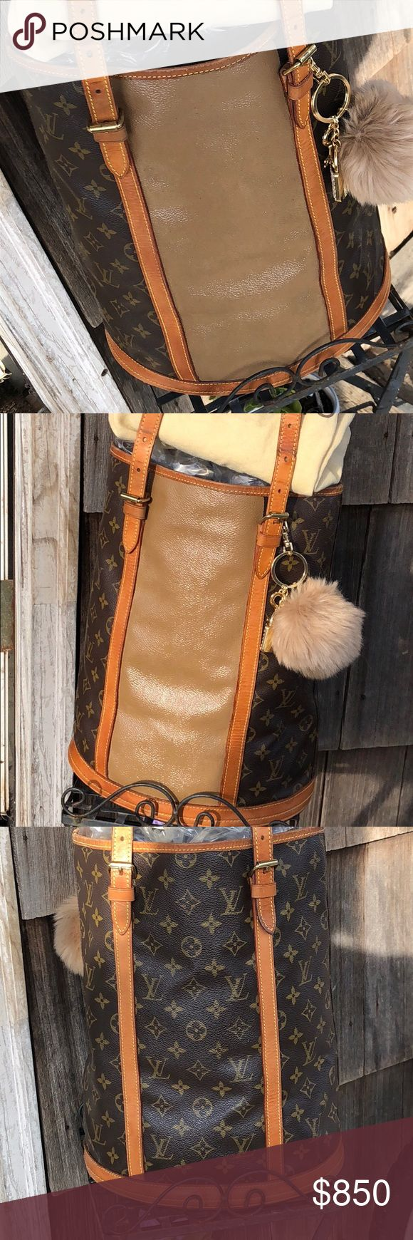"""💖LOUIS VUITTON GM BUCKET BAG 💖 A Beauty 💖!! Beautiful Authentic Louis Vuitton brown monogram Large """"GM"""" bucket Shoulder bag ,  repurposed ! As you see in pics Great preloved condition for its age, but still has lots of life left. Definitely well loved & used ! 💖 Date code AR0997. Oldie but beauty 💖! Gorgeous patinaed straps & trim , you can wear either side . Chain & hook in there to hook a wallet or coin purse. Original dust bag included , Inside normal wear but no peeling. Any Q's…"""