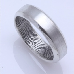 finger print ring........Possible idea for an anniversary gift. Gift him with a new alternate wedding band with your finger print inside so your always with him