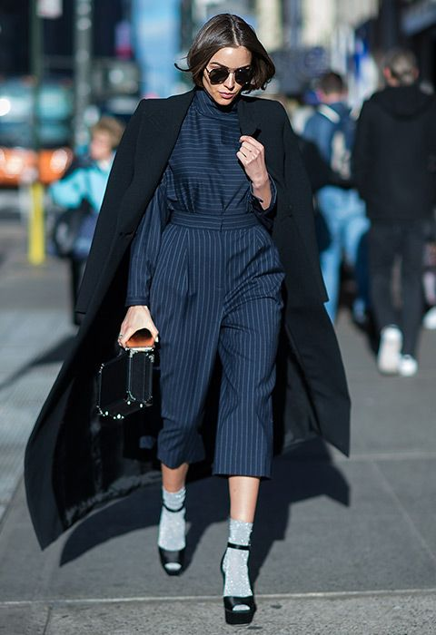 For the perf desk-to-dinner-date get-up, it's all about the pinstripe jumpsuit – bringing the sass with a nipped-in waist and cropped leg. Break that socks and sandals rule like Olivia Culpo by wearing a glittery pair teamed with peep-toe platforms. Round off the look with a box clutch and a weather-appropes oversized coat