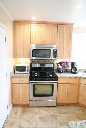 The newly remodeled kitchen with maple cabinets granite for Dream kitchen appliances