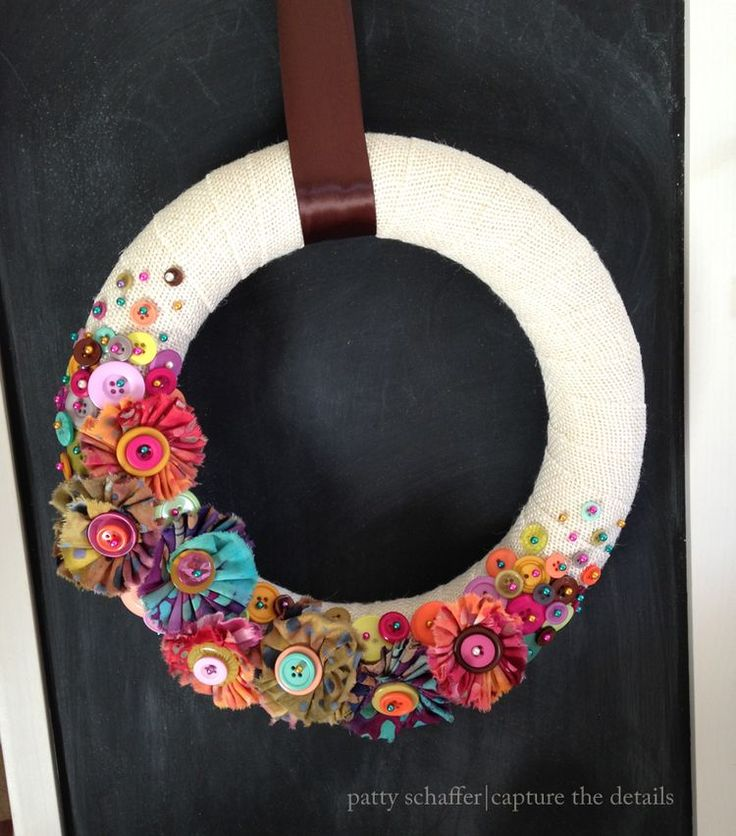 burlap wreath with frayed fabric and button flowers | designed by Patty Schaffer for Blumenthal Lansing Company