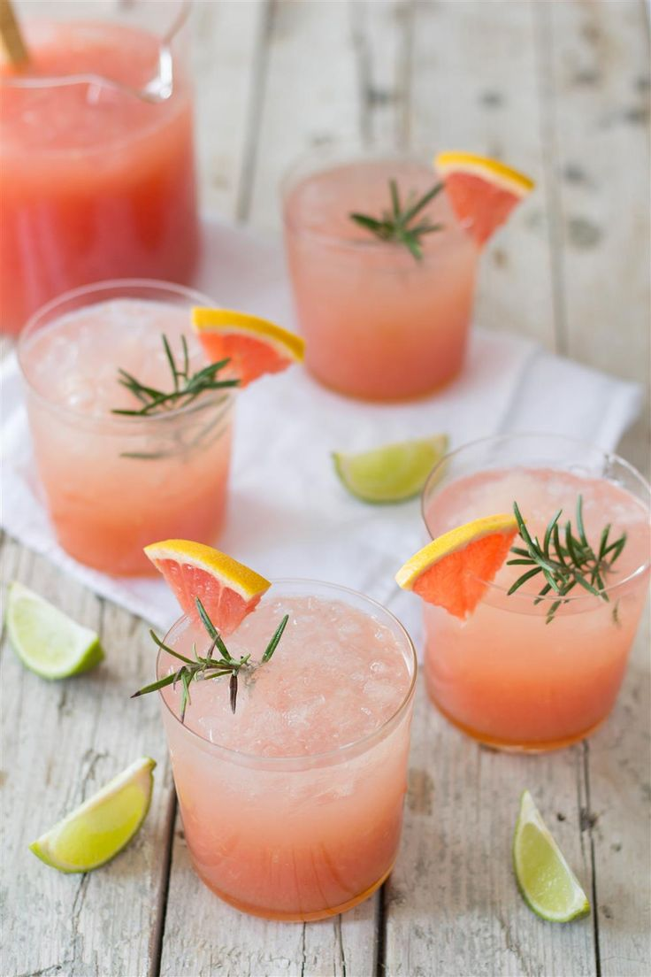 A cold grapefruit-lime cocktail with ginger and rosemary to take you to your favourite beach!