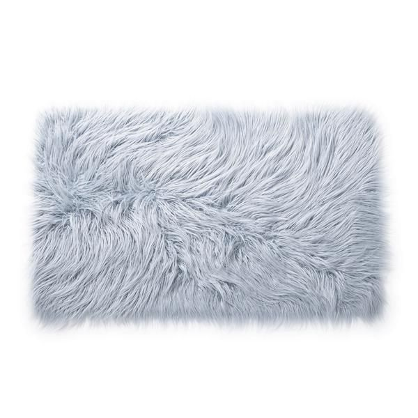 Faux sho. This multi-functional and chic rug is the perfect addition to any small space dweller space looking to elevate design in a big way. In a blend of pale blue tones, this rug creates a cool and cozy ambiance. Place this soft rug as an accent piece next to your bed or coffee table. And with a non-slip backing, this rectangle soft pink faux mongolian scatter rug won't slip around.