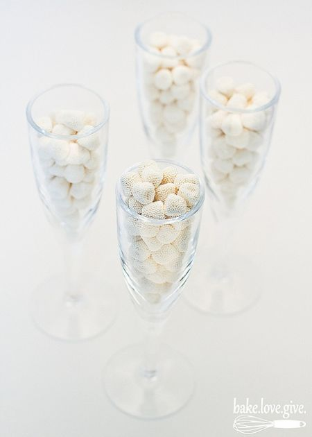 Champagne flutes filled with champagne bubble candy.  See more candy wedding favors and party ideas at www.one-stop-party-ideas.com