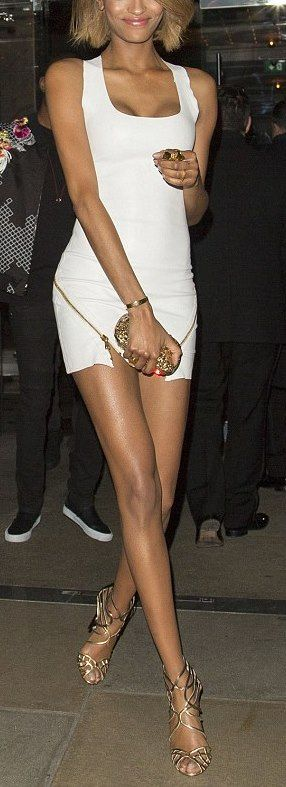 Jourdan Dunn white mini dress with gold zipper detail and gold sandals (at the London EDITION hotel in London, England, on December 2, 2014)