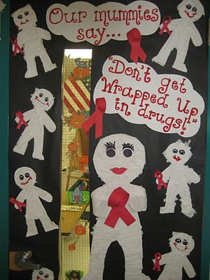 red ribbon week door display with mummies