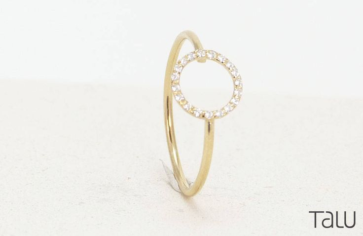 A personal favourite from my Etsy shop https://www.etsy.com/listing/510302128/circle-diamond-ring-gold-diamond-ring