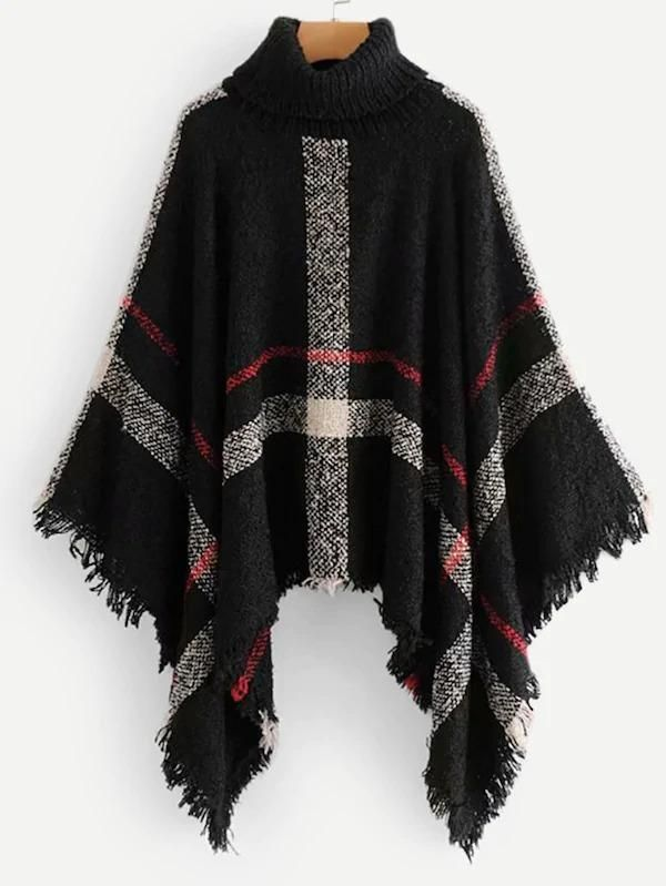 Black Ponchopullover with fringe and hole pattern hand knitted
