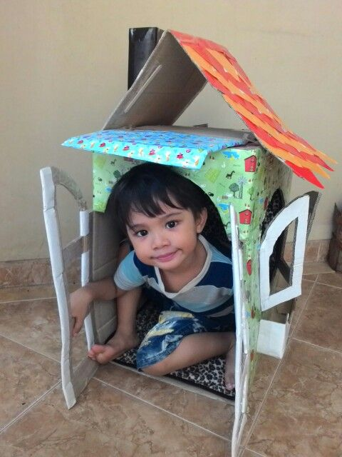 He likes playing a #cardboard #house #toy #diy #craft
