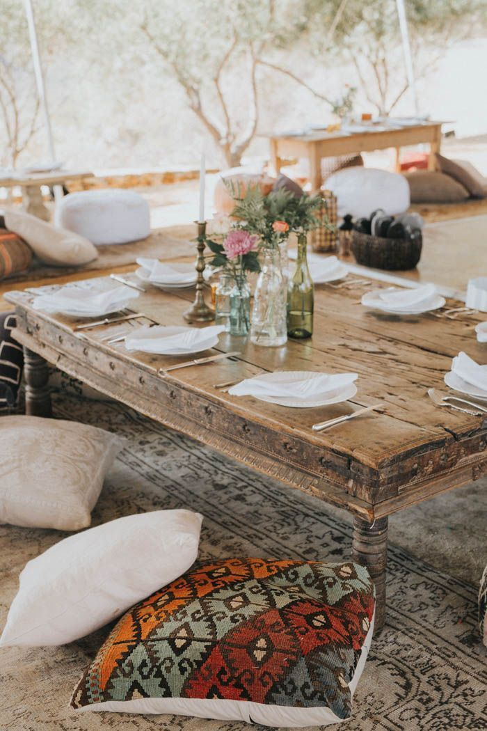 Moroccan-inspired pillows + low tables create a cozy reception space | Image by Kindred Weddings