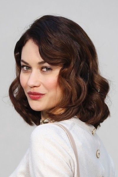 Olga Kurylenko Medium Curls - Olga Kurylenko showed off perfectly sweet curls at the Chanel Haute Couture show.