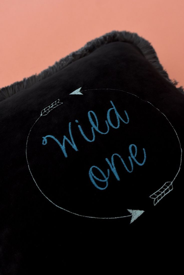 Velvet cushion with embroidered typography