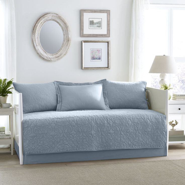 A beautiful scroll stitch on th is Laura Ashley quilt set is inspired by a  classic
