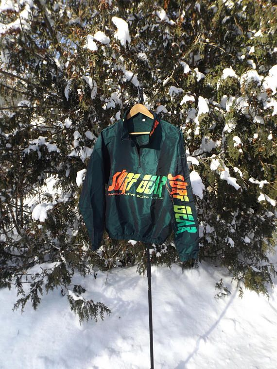 Surfstyle took over the 90s with their bright, shiney, neon filled windbreaker jackets. They also inspired a ton of off brand models and this Surf Gear windbreaker is one of them. Pretty incredible and actually a great light jacket for adventures or just daily use. It is in good shape