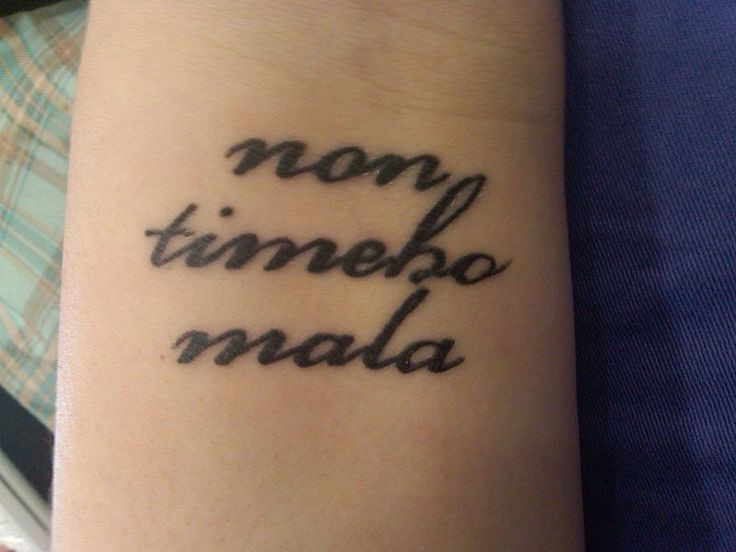 'Non timebo mala' tattoo ; this comes from Supernatural and means 'I fear no evil' love the placement of this.