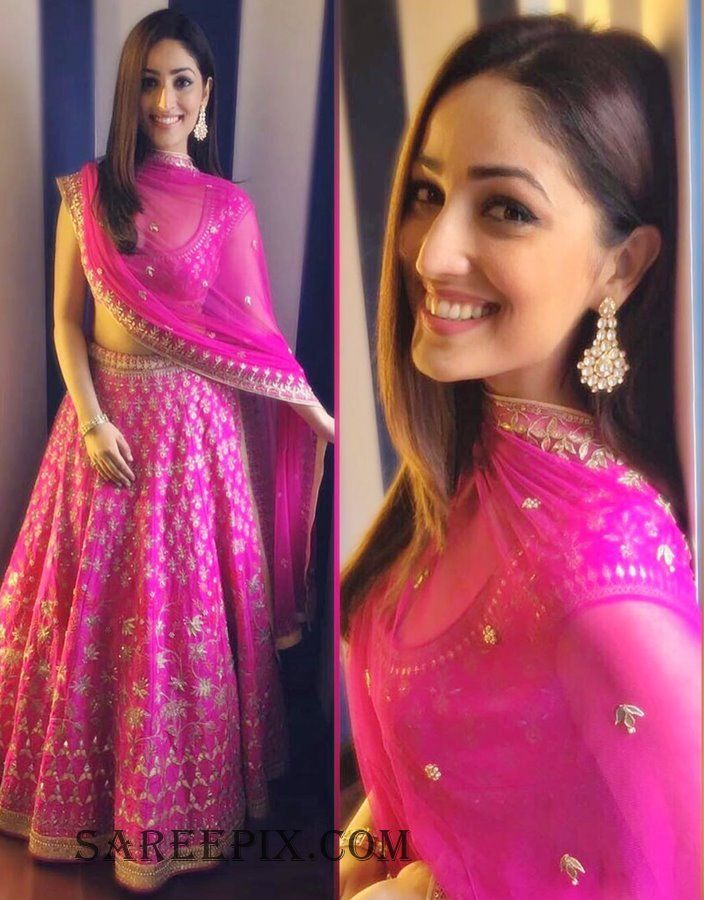 """""""Kaabil"""" beauty Yami Gautam beautiful in pink Anita dongre lehenga for Vogue wedding weeek. One side swept hairstyle and cute smile finished her pretty loo"""