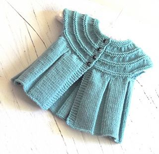This cute little top can be knitted with or without sleeves. If knitting up the sleeveless top there is no seaming involved, if adding sleeves, the only sewing involved is the sleeve seams. A very simple knit which I would rate and easy. Would make the perfect baby shower gift.
