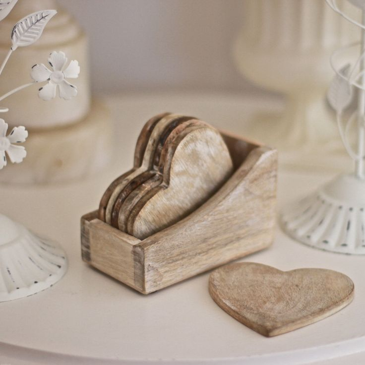 This gorgeous set of 6 wooden heart-shaped coasters sits in its own box looking lovely. Relax with a cup of tea in the knowledge that you're not spoiling your furniture! DIMENSIONS: 10 x 12 x 7 cm