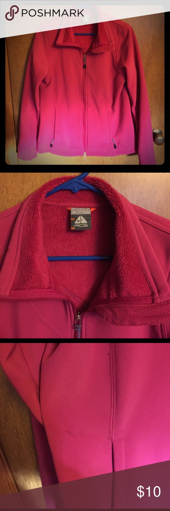 Nike ACG jacket Pink ACG jacket lined. Has a small mark under right arm (in picture) and two small marks on shoulder on the back (pictured) Nike Jackets & Coats