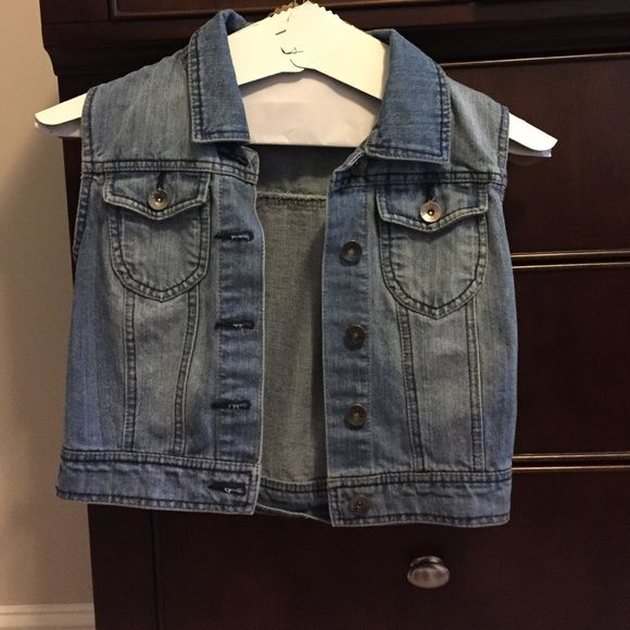 Sleeveless Denim Jacket Cute denim jacket with lace detail on the back. With cut off sleeves. Only worn a few times, great condition. It is a juniors medium. Ci Sono Jackets & Coats Jean Jackets
