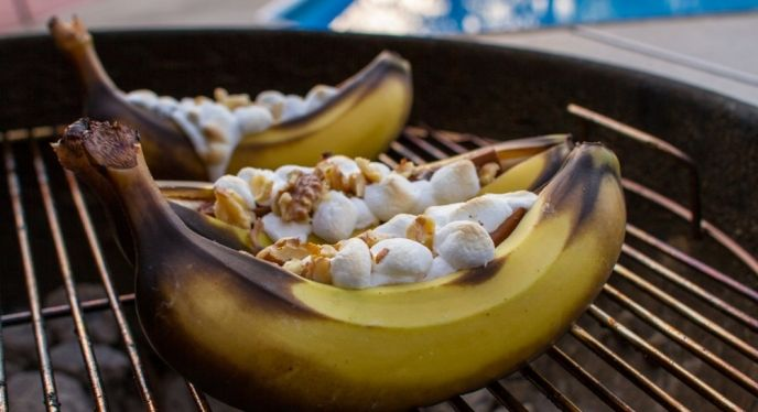 Banana Boats- Grilled bananas (on a #madeinUSA weber charcoal grill) stuffed with marshmallow, chocolate and walnuts