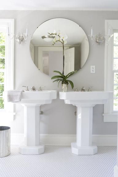Bathrooms gray bathroom double white pedestal sinks for Round bathroom wall mirrors