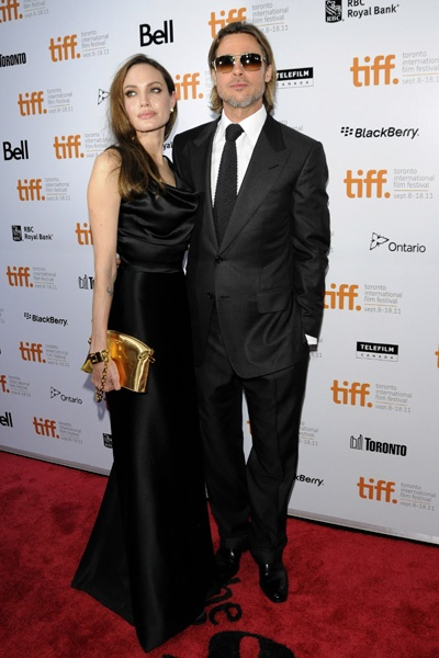 Brad Pitt and Angelina Jolie look money at Moneyball premiere