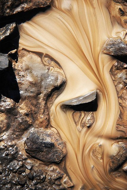Title: Simplicius Photograph of sand in water by Sylvain Meyer