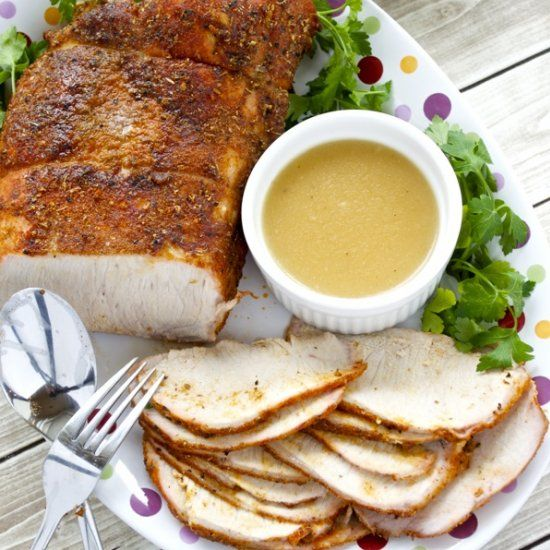 A fresh loin of pork is seasoned with a flavorful spice rub and roasted to juicy perfection. The drippings make the BEST gravy!