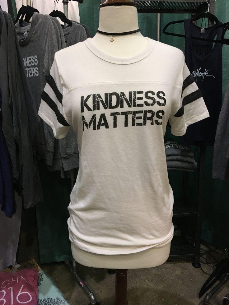 Kindness Matters vintage football Unisex tee in cream by Arthur Nolan