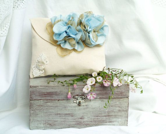 White cotton clutch with blue silky flowers by circlestories, $28.00