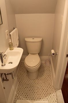 Small powder room - note the half size, but still stylish, sink