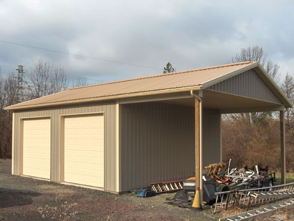 26x40x12 with gable roof extension Accessory building painted steel 12 overhangs ceiling