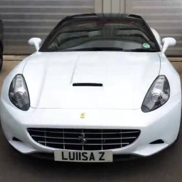 Luisa Zissmans White Ferrari California.. check out her number plate!