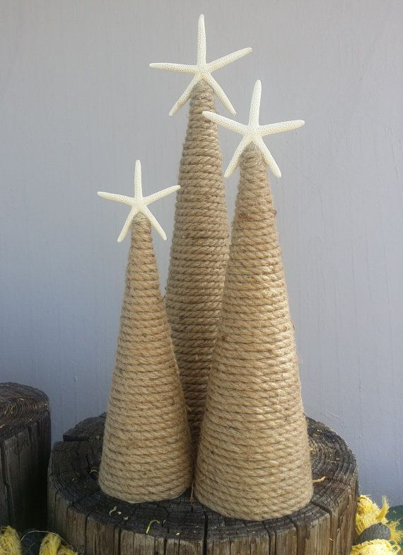 Dreaming of a White Sandy Christmas? Our chic & classic design is a simple, clean, & attractive style- perfect for Coastal Living Home Decor. Our Nautical Rope Christmas Trees are the perfect budget friendly decoration for gift giving & decorating. Your tree(s) will come carefully packaged and ready to display- complete with a real white starfish topper. Add your own accents to a lovely mantle display in whatever color theme floats your boat- the natural rope color combines perfec...