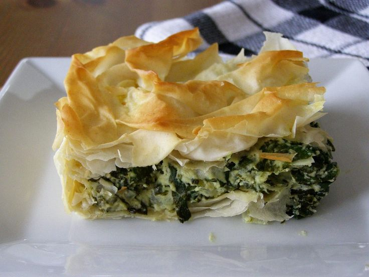 Spanakopita is a Greek traditional pie. Its filled with chopped spinach and feta cheese. The filling is wrapped and layered in filo pastry. Spanakopita is mostly eaten as a snack in Greece.
