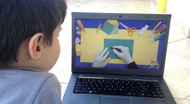 O Miguel concentrado no vídeo do PlayKids SuperHands