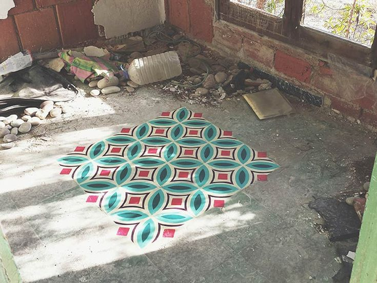 The street art project Floors Installationby Spanish artistJavier de Riba, based in Barcelona, who paints colorful tile patterns with stencils on the floor