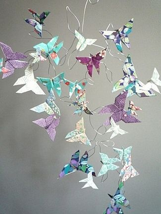 21 DIY Butterflies Wedding Theme & Ideas | Confetti Daydreams. DIY Origami Butterfly Mobile - Featured by Karinethiboult.over-blog, learn how to create this unique hanging wedding decor idea using origami butterflies.