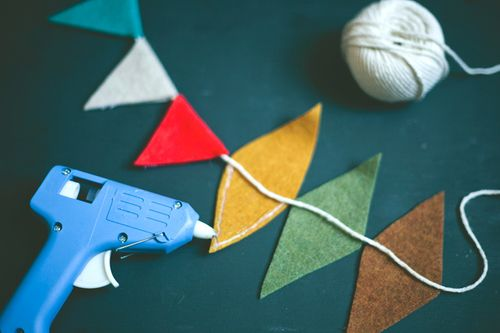 DIY bunting for nursery. Great idea to use up left over fabrics from the room
