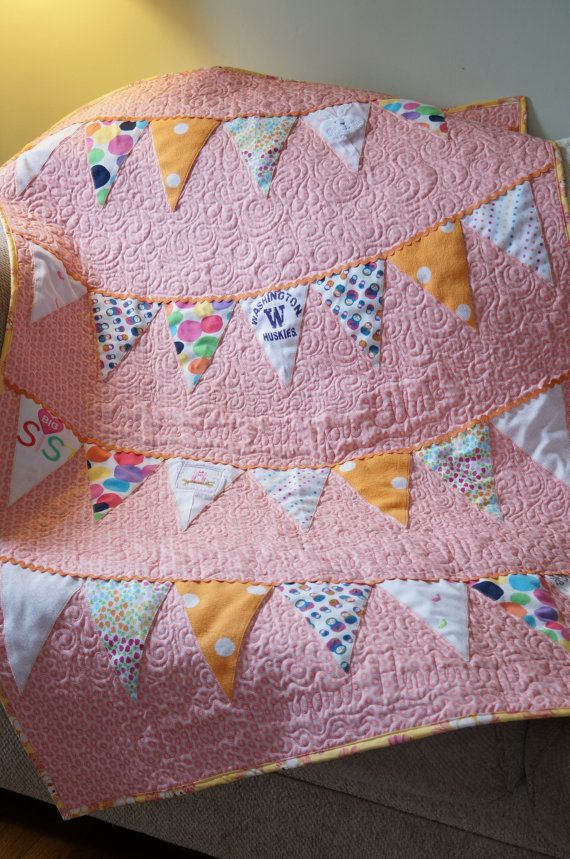 This is a custom made baby quilt, made from your childs first year of baby clothes!  Preserve those baby clothes forever! This would make a fantastic