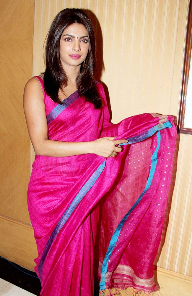 Priyanka Chopra looked resplendent in in a pink woven saree from Kolkata with blue border at the Priyadarshni Academy's Global Awards event in Mumbai. #Bollywood #Fashion #Style #Beauty