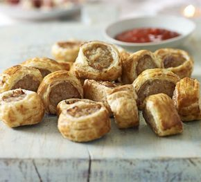 Everybody's favourite party food. John Torode's trick is to add water to the sausage mix, which makes the pastry puff up