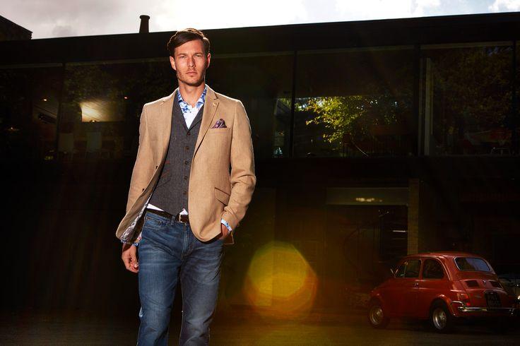 Tan blazer with dark grey waistcoat and denin blue jeans by Guide London