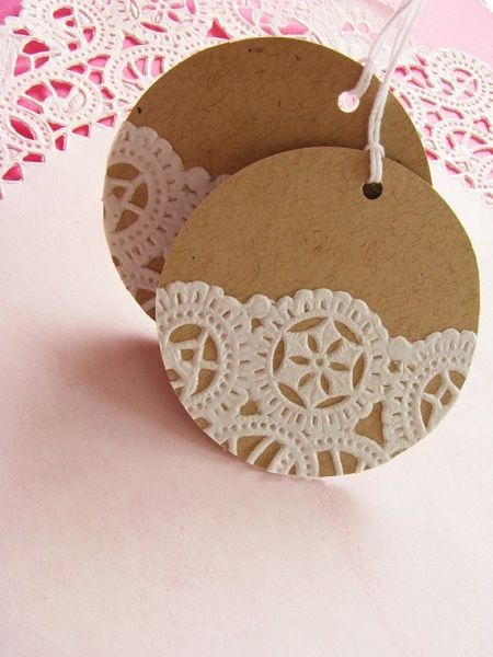 Make a lovely doily tag by gluing a piece of a doily  to a pre-cut tag in any shape you like.