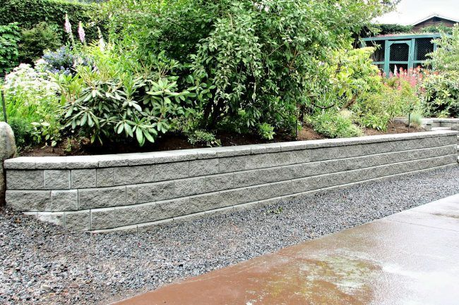The Cost Of A Retaining Wall Depends On The Material Used The Size Of The Wall And Labor Woo In 2020 Garden Stepping Stones Pathway Landscaping Stone Retaining Wall