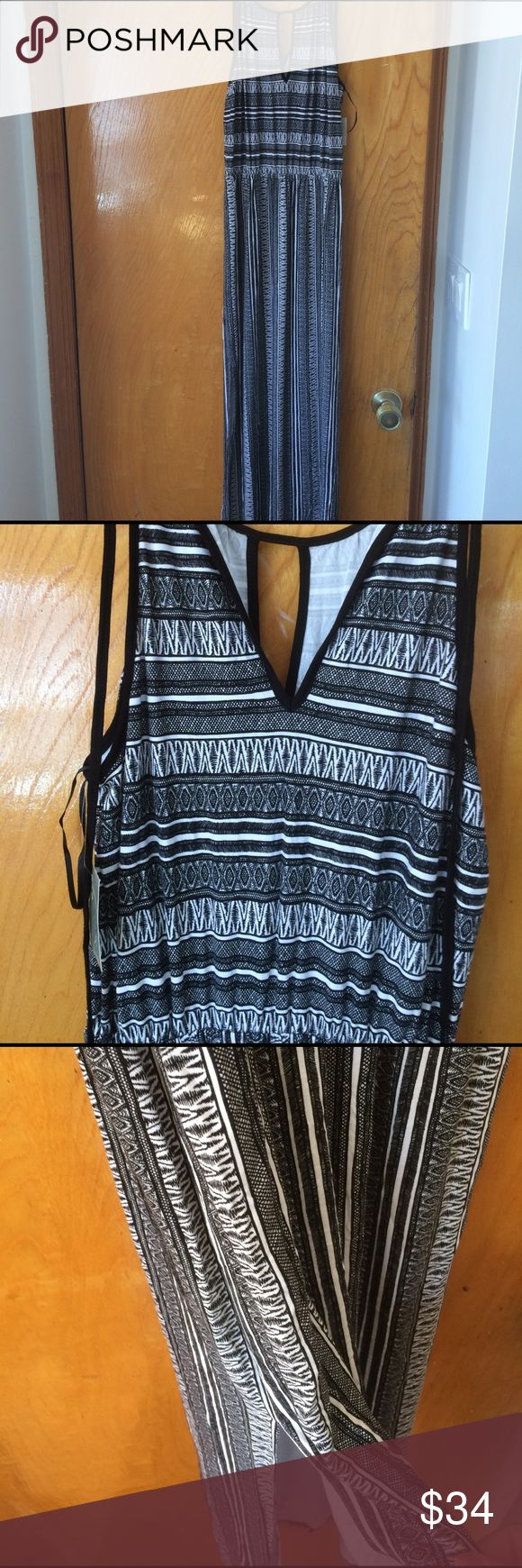 Black and white dress Black and white long dress with slits at the bottom seen in picture 3 ambar size extra small with tags ambar Dresses Maxi