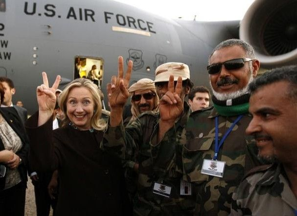 Hillary with the muslim brotherhood whom she and Obama helped take over Libya. Stop sharia law.