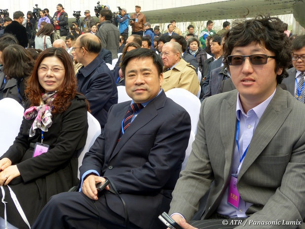 Honav chief Jack Chen (center), with wife Lily and assistant Ding Wen.
